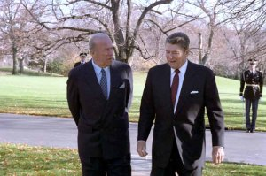 George Shultz walking with President Reagan outside the White House in December 1986.