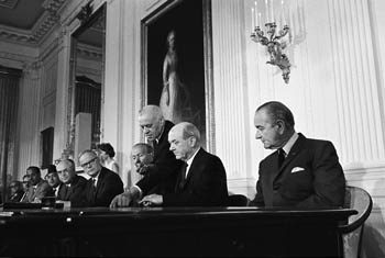 President Lyndon Johnson looking on as Secretary of State Dean Rusk prepares to sign the NPT, 1 July 1968. (Source: Lyndon B. Johnson Presidential Library.)