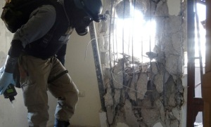 A UN chemical weapons inspector at one of the sites of the Aug. 21 chemical weapons attack in the Damascus suburb of Zamalka
