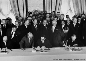 Signing of the Partial Test Ban Treaty, 5 August 1963. Secretary of State Dean Rusk signing for the United States; Foreign Minister Andre Gromyko, signing for the Soviet Union; and Lord Hume signing for the United Kingdom. Photo: CTBTO.