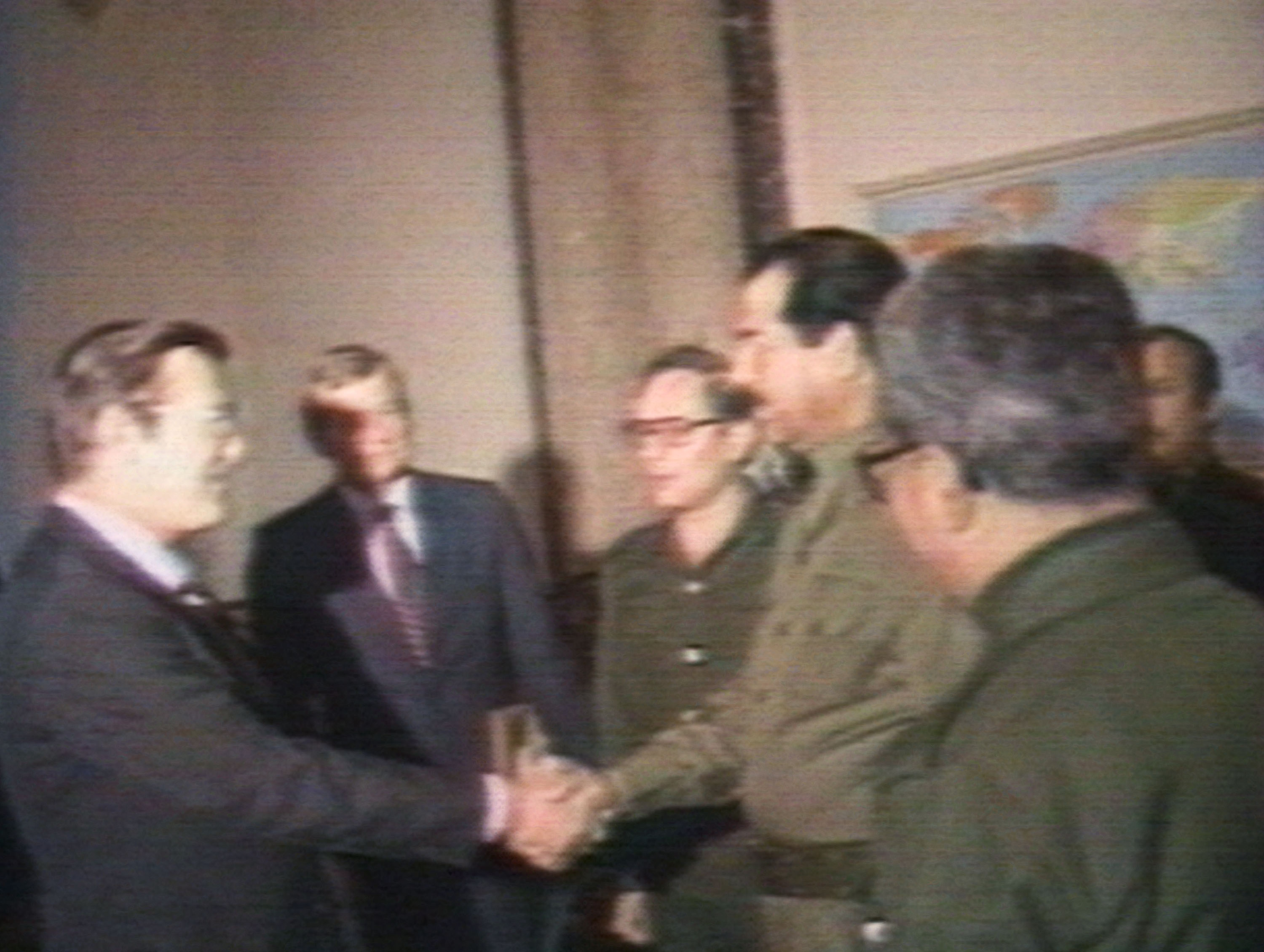 BAGHDAD, IRAQ - (VIDEO STILL) U.S. Secretary of Defense Donald Rumsfeld and Iraqi President Saddam Hussein shake hands December 20, 1983 in Baghdad. Rumsfeld met with Hussein during the war between Iran and Iraq as an envoy for former U.S. President Ronald Reagan. Rumsfeld made no reference to Iraq's use of chemical weapons, according to detailed official notes on the meeting. (Photo by Getty Images)