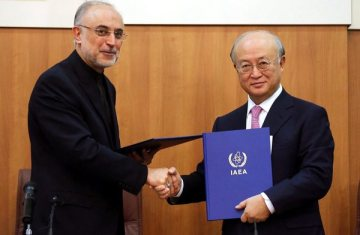 The head of Iran's Atomic Energy Organization, Ali Akbar Salehi and Yukiya Amano, Director General of  the International Atomic Energy Agency chief Yukiya Amano, right, after signing an agreement in Tehran on November 11 giving the agency greater access to some nuclear sites in Iran. (Credit: European Pressphoto Agency)