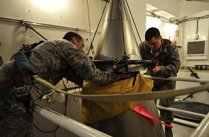 U.S. Air Force personnel perform New START Treaty inspection training on a Minuteman III ICBM payload section at Minot AFB in 2011.