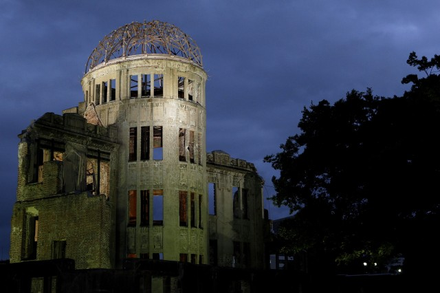 A-Bomb Dome is seen near Hiroshima Peace Memorial Park on August 5, 2010 in Hiroshima, Japan, on the eve of the 65th anniversary of the Hiroshima atomic bombing. The world's first atomic bomb was dropped on Hiroshima by the United States during World War II, killing an estimated 70,000 people instantly with many thousands more dying over the following years from the effects of radiation. Three days later another atomic bomb was dropped on Nagasaki.  (Photo by Kiyoshi Ota/Getty Images)